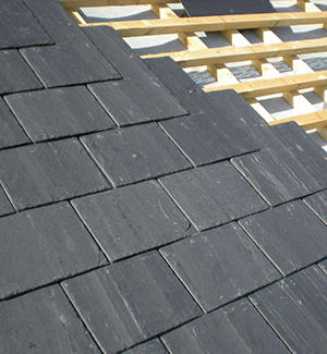 Part way through a slate roof in Salford